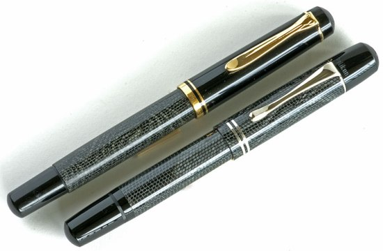 Pelikan R200 Snakeskin rollerball next to an M101N Lizard fountain pen