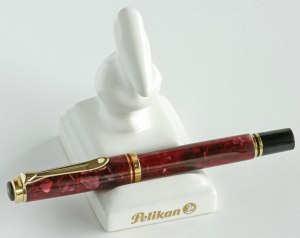Pelikan Ruby Red M320 with small porcelain pen stand