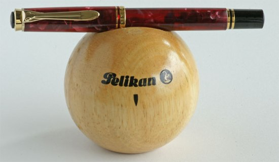Pelikan Ruby Red M320 with wooden Pelikan stand