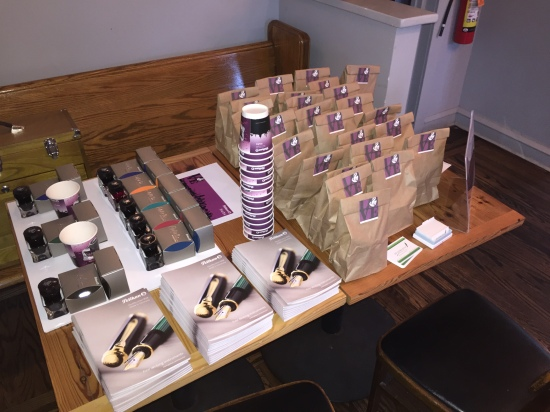 "Ink sampling table and ""swag bags"""