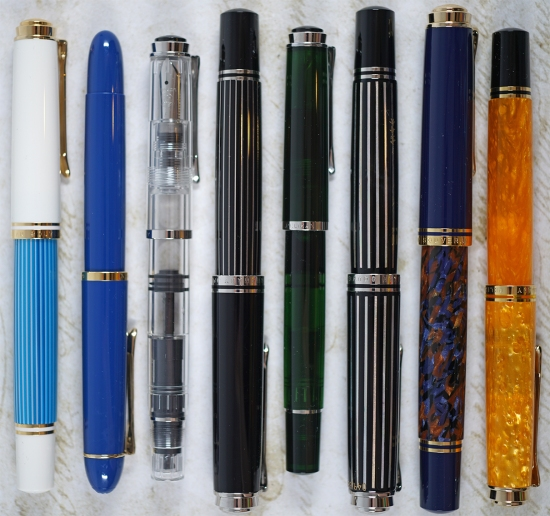 Pelikan's 2018 releases: M600 Turquoise White, M120 Iconic Blue, M205 Classic Demonstrator, M815 Metal Striped, M205 Olivine, M805 Raden Royal Platinum, M800 Stone Garden, M600 Vibrant Orange