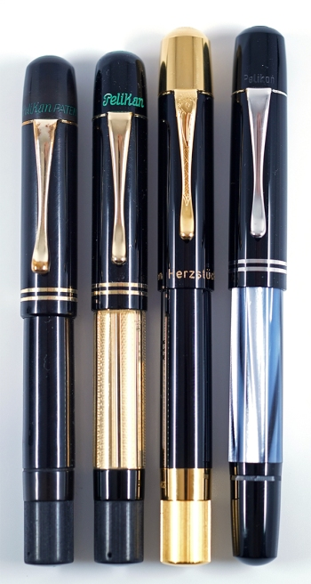 Pelikan 100, M101 Gold, Herzstück 1929, and M101N Grey-Blue fountain pens